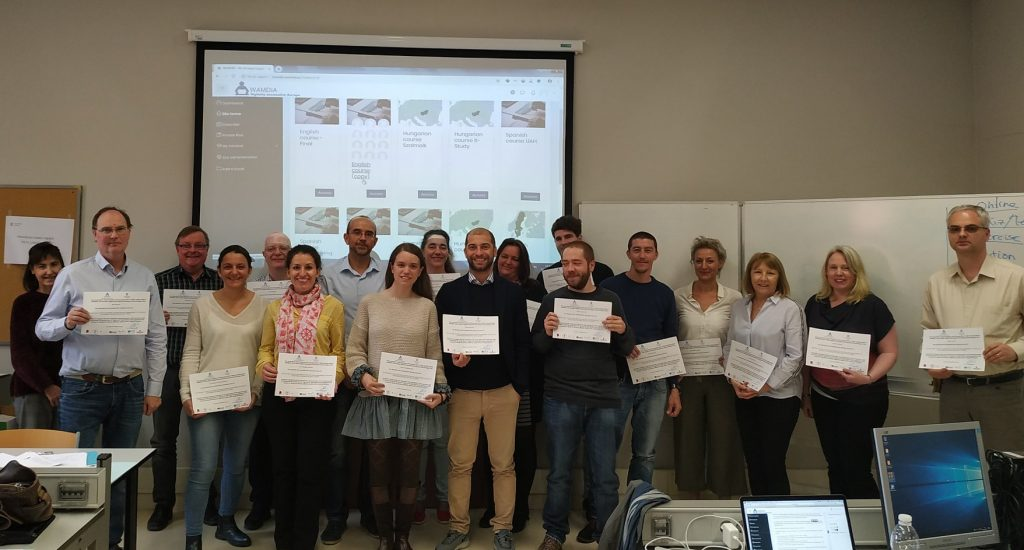 Picture of all instructors showing a diploma.